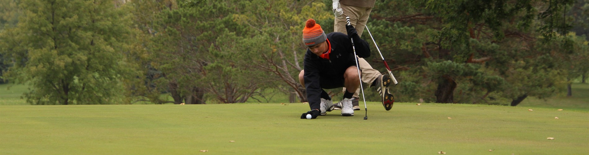 Junior Brandon Kubly prepares to putt on Hole 18 at Rocky Run during the 2018 State Golf meet.