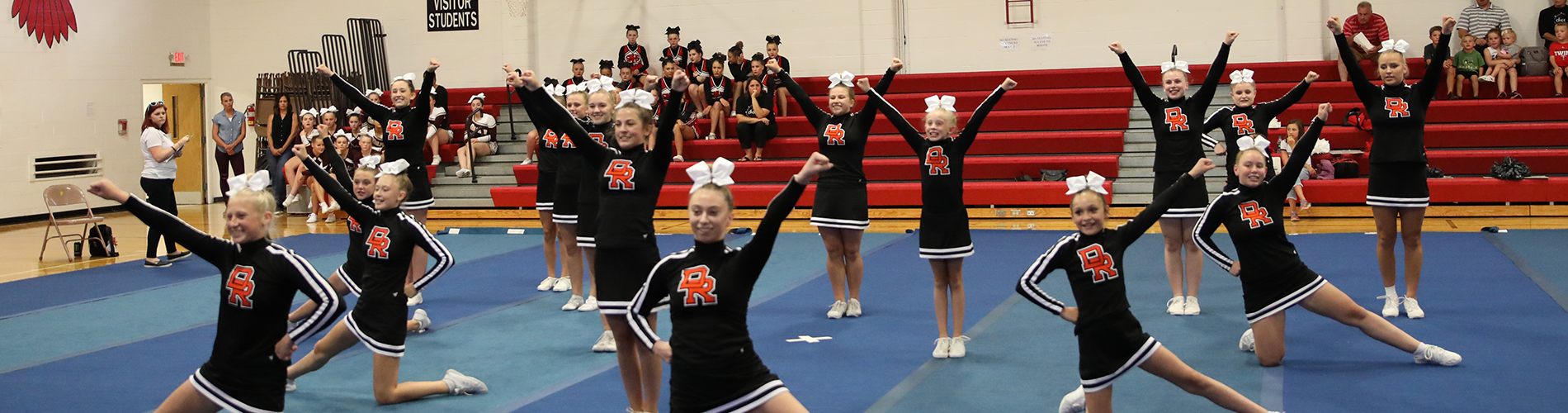 Competitive cheer members finish their routine.