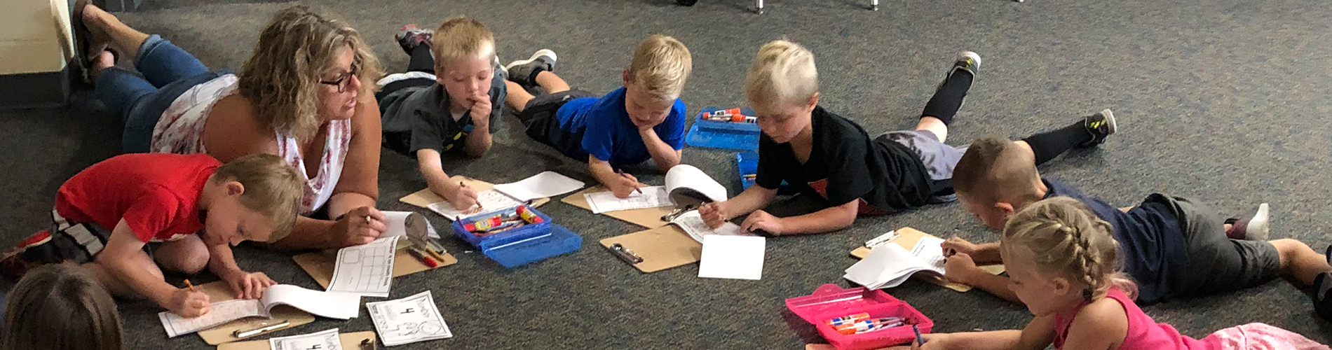 Elementary students work on their number 4 packets.