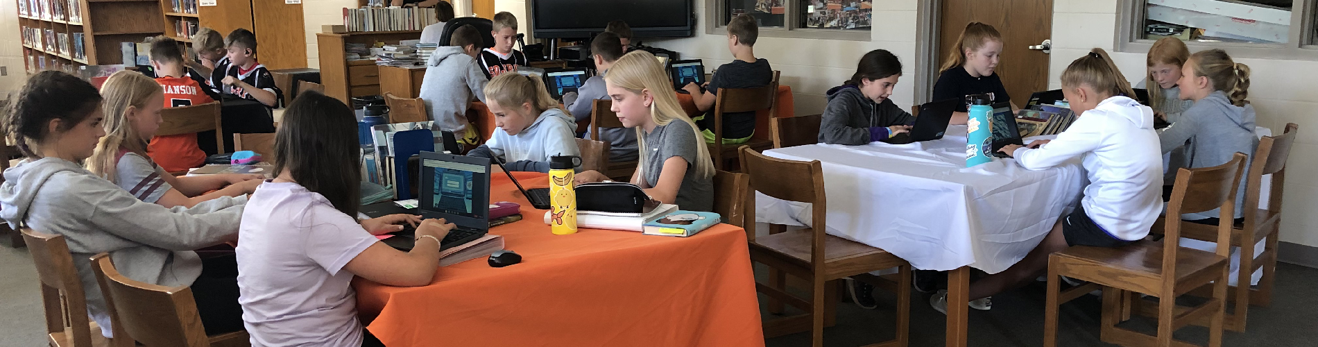 6th-grade students practice their keyboarding skills in the library.