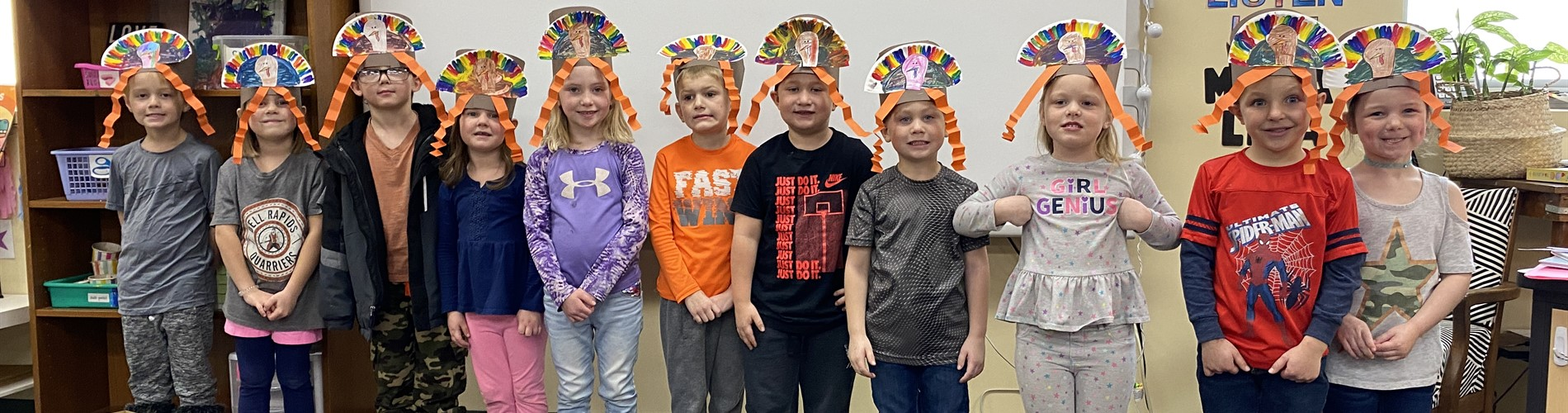 Elementary school students wearing their turkey hats from art class.